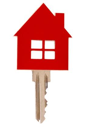 investment real state: casa llave en el fondo blanco Foto de archivo