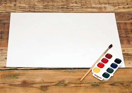 Set of used paint bruch with paper on wood background Stock Photo - 17947753