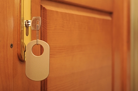 key with blank tag at door Stock Photo - 18094974