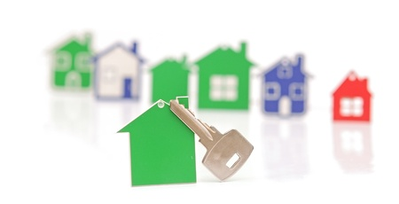 silver key with blank label shaped home. space for your text photo