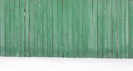 snow drift: Old wooden fence in a snow drift  Stock Photo