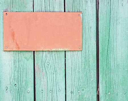 wooden signboard: Wooden signboard hanging on planks background  Stock Photo