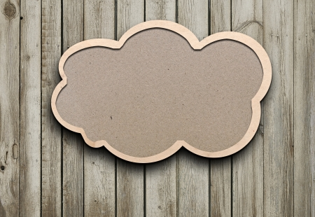 blank recycled paper speech bubble on wood background  Standard-Bild