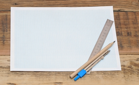 Still life photo of engineering graph paper with pencil, compass and metal ruler blank to add your own design photo