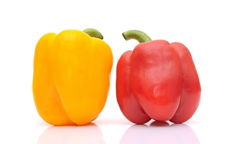 sweet yellow and red peppers isolated on white background photo