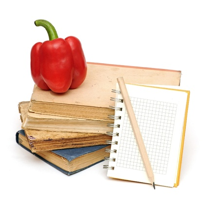 pencil on notebook near pile of books for your recipes, menu... photo