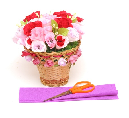 Paper flower in a basket with colorful paper and scissors  Stock Photo - 18962168
