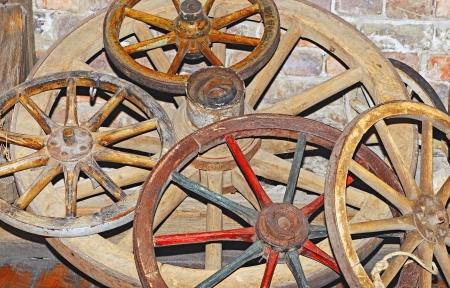 old wood farm wagon: Antique wagon wheel Stock Photo