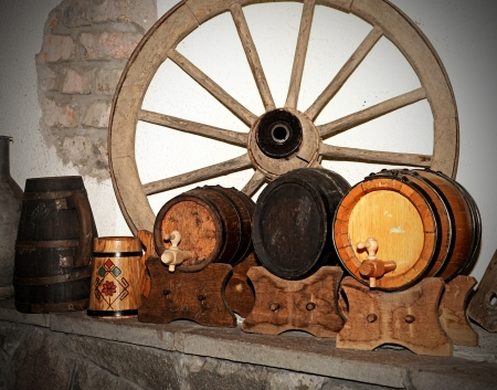Wooden wagon wheel and antique wooden small draught beer keg photo