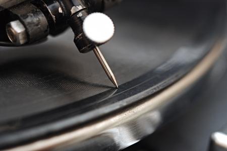 gramophone needle in vinyl records. A very extreme macro.