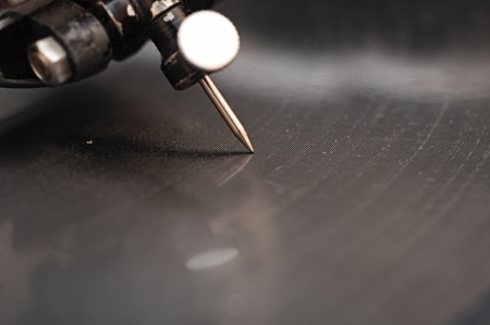 old gramophone needle and a black vinyl photo