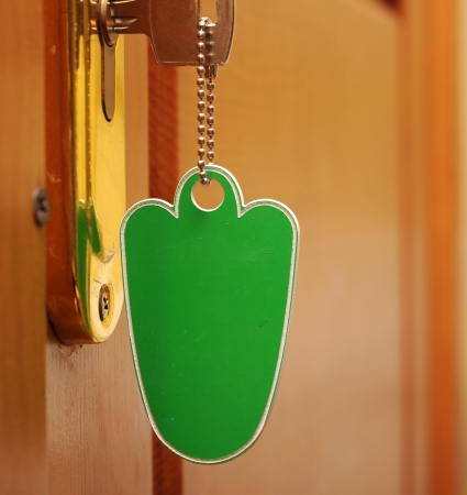 key in keyhole with blank tag  photo