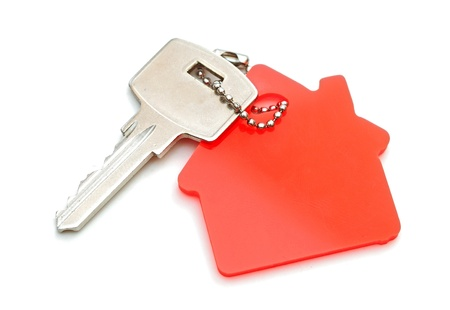 downpayment: House shaped keychain isolated on white background