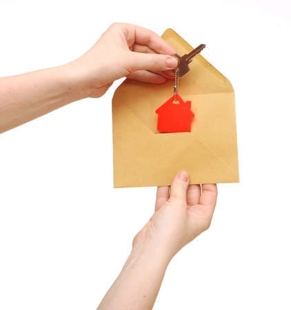 house symbol and key in open envelope photo