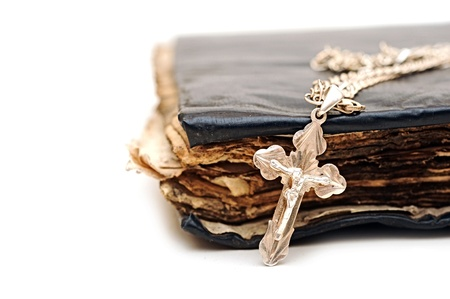 orthodoxy: Religion  A cross with a chain against a old book