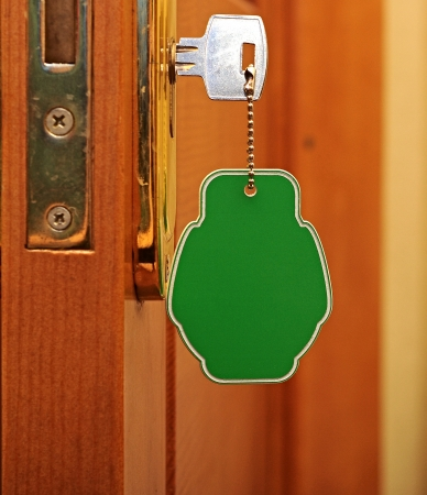 key in keyhole with blank label photo