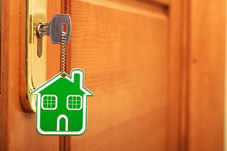 Simbolo della casa e incollare la chiave nella serratura Archivio Fotografico - 19713101