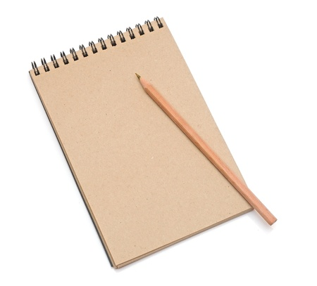 recycled paper notebook with pencil isolated on white photo