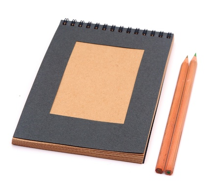 recycled paper notebook with pencils isolated on white photo