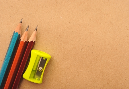 recycled paper notebook with colorful pencils photo
