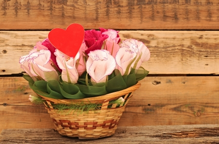 Paper flower in a basket over wooden background. Love concept Stock Photo - 20073501