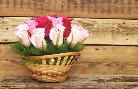 Paper flower in a basket over wooden background. Love concept photo