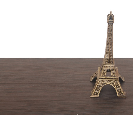 eiffel tower statue on wooden background photo