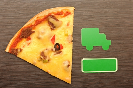 pizza car delivery to home, wooden background.  photo