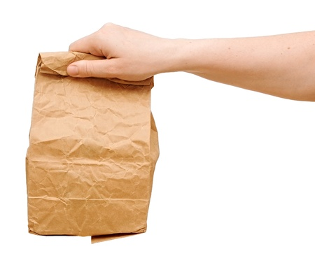 paper bag: female holding a brown paper bag with contents in his hand