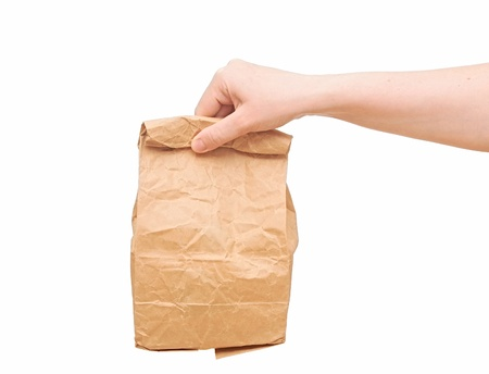 female holding a brown paper bag with contents in his hand photo