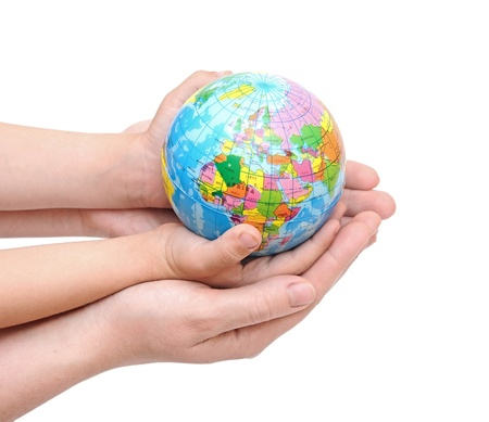 mother earth: Globe in babys hands, isolated on a white background Stock Photo