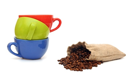 colorful cups of coffee and beans isolated on white background  photo