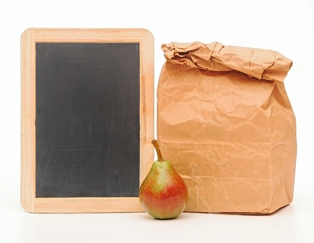 school lunch bag with blank blackboard on white photo