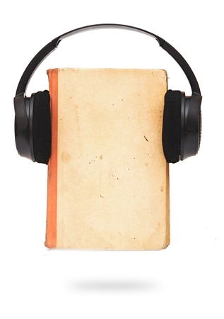 black headphones and book on a white background  photo