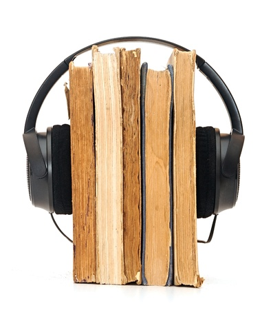 Headphones around books suggesting listening to books instead of reading them  photo