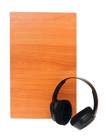 black headphones over wooden background on a white  photo