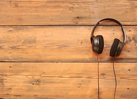 headphones: stylish headphones on a grungy wooden table