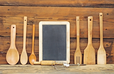wooden cutlery and blank blackboard with copy space  photo