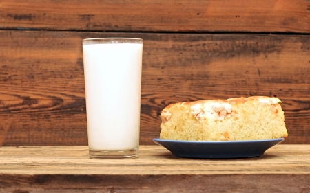 Homemade pie with apples and a glass of milk  photo