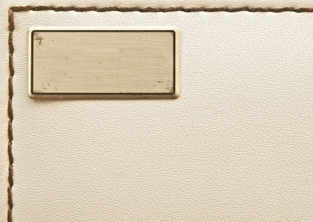 metal label on old leather background Stock Photo - 22513331