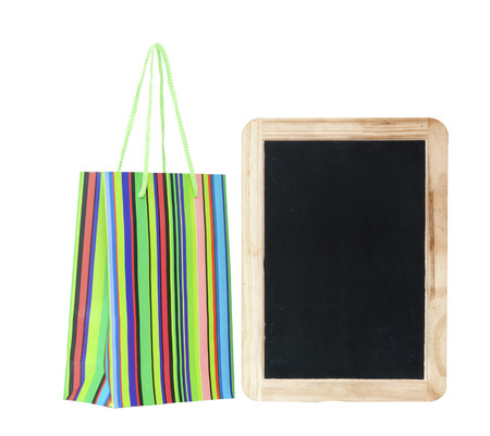colorful shopping bag with blank chalkboard photo