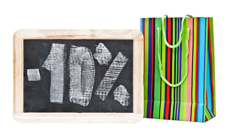 Ten percent written on blackboard with colorful shopping bag photo