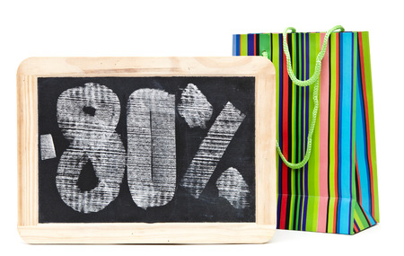 eighty percent discount written on blackboard with colorful shoping bag  photo