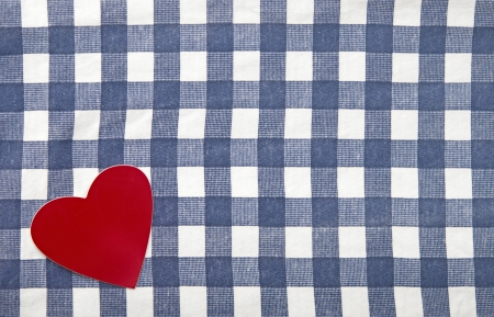 red heart shape on checkered textile  photo