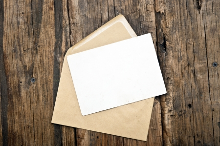 index card: Blank postcard and envelope on old wooden background