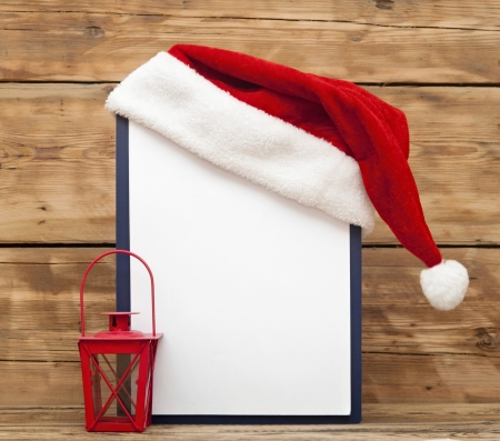 Santa hat on clipboard with blank sheet of paper for your text  photo