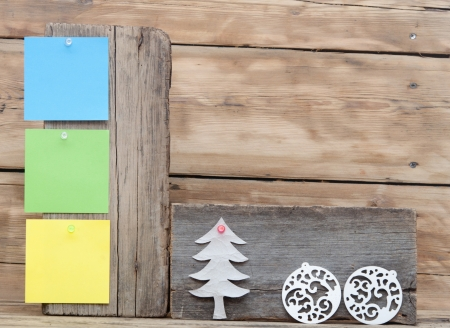 colorful reminder notes attached on a old wooden signboard with christmas decorations photo