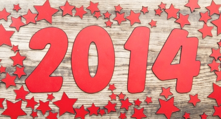 stars background and number 2014 on a old wooden background. Happy New Year photo