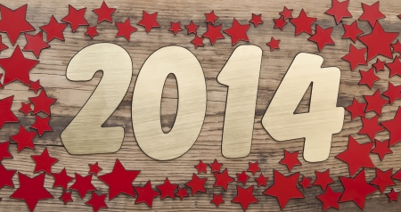 stars background and golden number 2014 on a old wooden background. Happy New Year photo