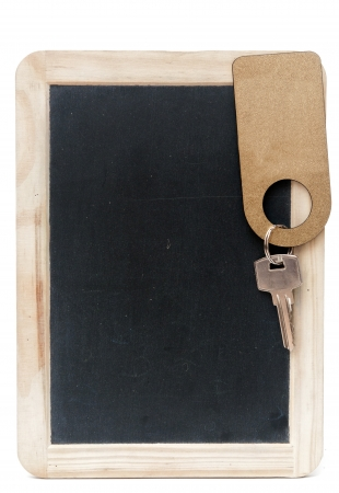 key with blank label on small school wooden blackboard  photo